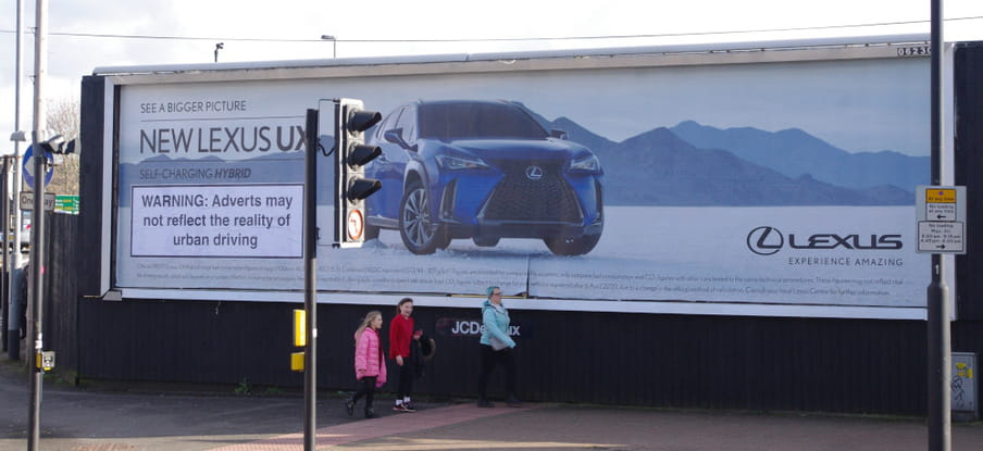 Warning: Adverts may not reflect the reality of urban driving. Beeld Brandalism
